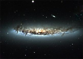 Galaxy Cleaned Out by Encounter with Hot Cluster Gas
